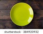 empty plate on rustic wooden... | Shutterstock . vector #384920932