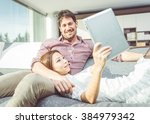 happy couple watching things on ... | Shutterstock . vector #384979342