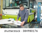 man in bus depot | Shutterstock . vector #384980176