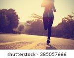 young fitness woman runner... | Shutterstock . vector #385057666