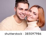 young couple in love embracing... | Shutterstock . vector #385097986