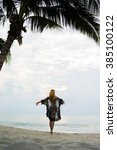 woman under the coconut trees...   Shutterstock . vector #385100122