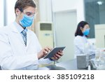 people doing medical experiment ... | Shutterstock . vector #385109218