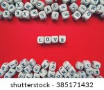 word love of small white cubes ...   Shutterstock . vector #385171432