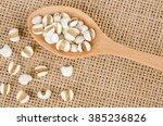 job's tears with wooden spoon ... | Shutterstock . vector #385236826