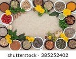 Small photo of Herbal medicine selection with fresh and dried herbs and spices forming an abstract background on natural hemp paper.