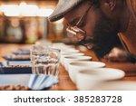 african man enjoying the aroma... | Shutterstock . vector #385283728