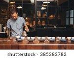 barista preparing coffee... | Shutterstock . vector #385283782