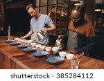 two baristas preparing a coffee ... | Shutterstock . vector #385284112