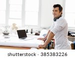 young man standing in creative... | Shutterstock . vector #385383226