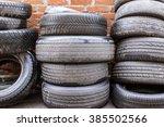 Used Tires At Red Brick Wall...