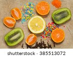 slices of fruit and spices  lie ... | Shutterstock . vector #385513072