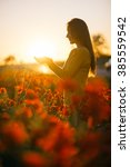 young woman holding sun in the... | Shutterstock . vector #385559542
