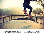 silhouette of skateboarder... | Shutterstock . vector #385593646