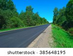 empty highway with green forest ... | Shutterstock . vector #385648195