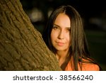 beautiful girl portrait in golden light near tree - stock photo