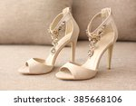 Bride's High Heel Shoes On Sofa