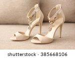 Bride's High Heel Shoes On Sofa