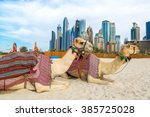 camel in front of dubai marina... | Shutterstock . vector #385725028