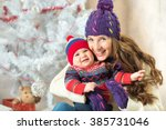new year boy and mom   Shutterstock . vector #385731046