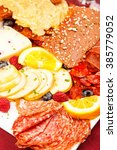 plate of assorted meats  cheese ... | Shutterstock . vector #385779052