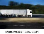 white semi truck on highway | Shutterstock . vector #38578234