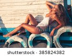 tanned young woman in bikini... | Shutterstock . vector #385824382