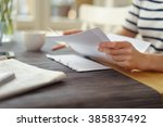 person seated at a table with a ... | Shutterstock . vector #385837492