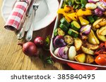 roasted vegetables in a ceramic ... | Shutterstock . vector #385840495
