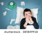 ill boy lying in bed. sad child ... | Shutterstock . vector #385849918
