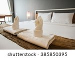 Stock photo two towels on the bed in hotel room 385850395