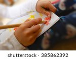Little Girl Drawing A Picture...