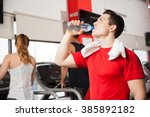 handsome young man drinking...   Shutterstock . vector #385892182