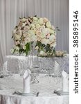 table setting at a luxury... | Shutterstock . vector #385895146