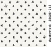 hand drawn snowflakes pattern.... | Shutterstock .eps vector #386084365