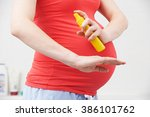 Pregnant Woman Spraying...