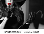 sexy dominant woman in hat and... | Shutterstock . vector #386127835