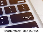 laptop pressing enter button | Shutterstock . vector #386150455
