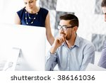 business people in modern office | Shutterstock . vector #386161036