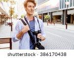 male tourist in city | Shutterstock . vector #386170438