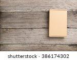 Cardboard Box On A  Wooden...