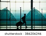 one man carrying a luggage at... | Shutterstock . vector #386206246