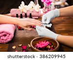 closeup finger nail care by... | Shutterstock . vector #386209945