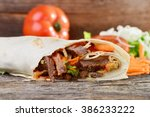 closeup of tasty kebab with... | Shutterstock . vector #386233222