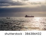 Sunrise And Cargo Ship In The...