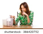 young girl running nebulizer... | Shutterstock . vector #386420752