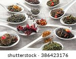 variety of dry tea in white... | Shutterstock . vector #386423176