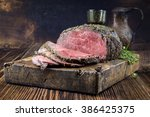 dry aged barbecue roast beef | Shutterstock . vector #386425375