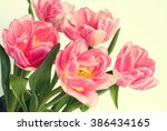 bouquet of pink tulips on a... | Shutterstock . vector #386434165