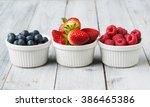assorted fresh juicy berries in ... | Shutterstock . vector #386465386